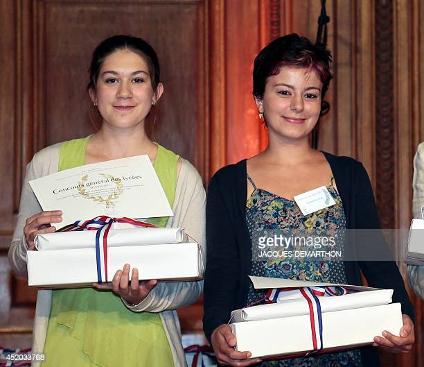 The laureates in the English category CamilleMai Lan Vo Van Qui 1st prize and Emmanuelle Rizk 2nd prize pose with their rewards during the prize...