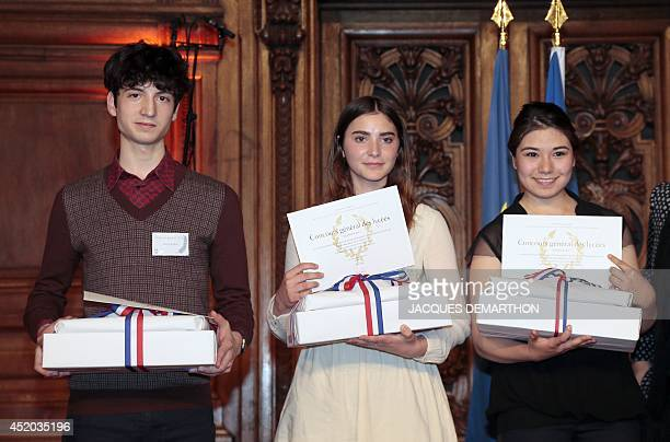 The laureates in the Musicology category Diego Rivéro 1st prize Rose Borel 2nd prize and Irène MejiaButtin 3rd prize pose with their rewards during...