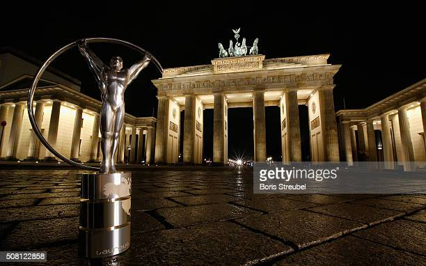 The Laureus Trophy is pictured in front of the Brandenburg Gate prior to the Laureus World Sports Awards 2016 on January 26 2016 in Berlin GermanyThe...