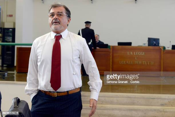 The lawer Fabio Anselmo stands near the sign 'La legge è uguale per tutti' during the New trial against five military police officers for the death...