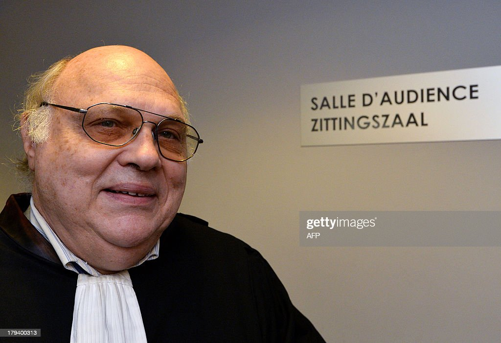 The lawyer defending the Belgian royal family, Guy Hiernaux, stands in a corridor on September 3, 2013 at the Court of First Instance in Brussels. Boel has gone to court to win official recognition as the natural daughter of former Belgian King Albert II. Boel, 45, has filed a suit requiring the former king, his son, Belgian King Philippe, and his daughter Princesse Astrid to appear in a Brussels court. Boel wants to get the court to order a DNA test so as to establish her relationship with the former king.