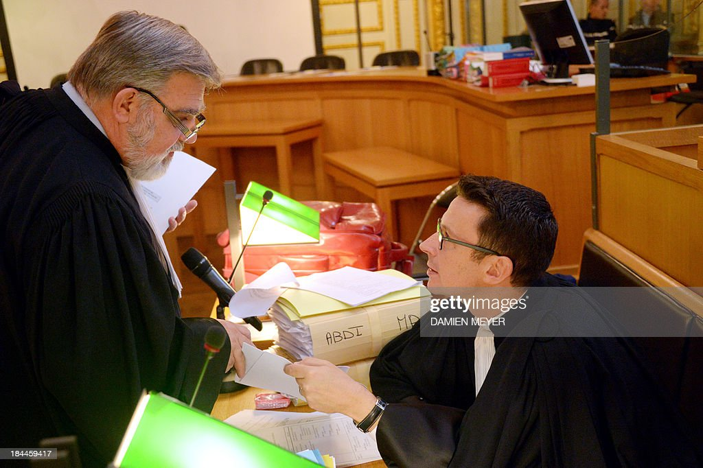 The lawyer for Lemacon's widow Chloe, Arnaud Colon de Franciosi (L) chats with lawyer Fabian Lahaie, on October 14, 2013 at Rennes' courthouse, prior to the opening hearing of the pirates' trial for hijacking a yacht in 2009. French troops stormed the Tanit sailboat on April 10, 2009 and captured the trio in a bid to free Florent Lemacon, his wife, their three-year-old son and two others.