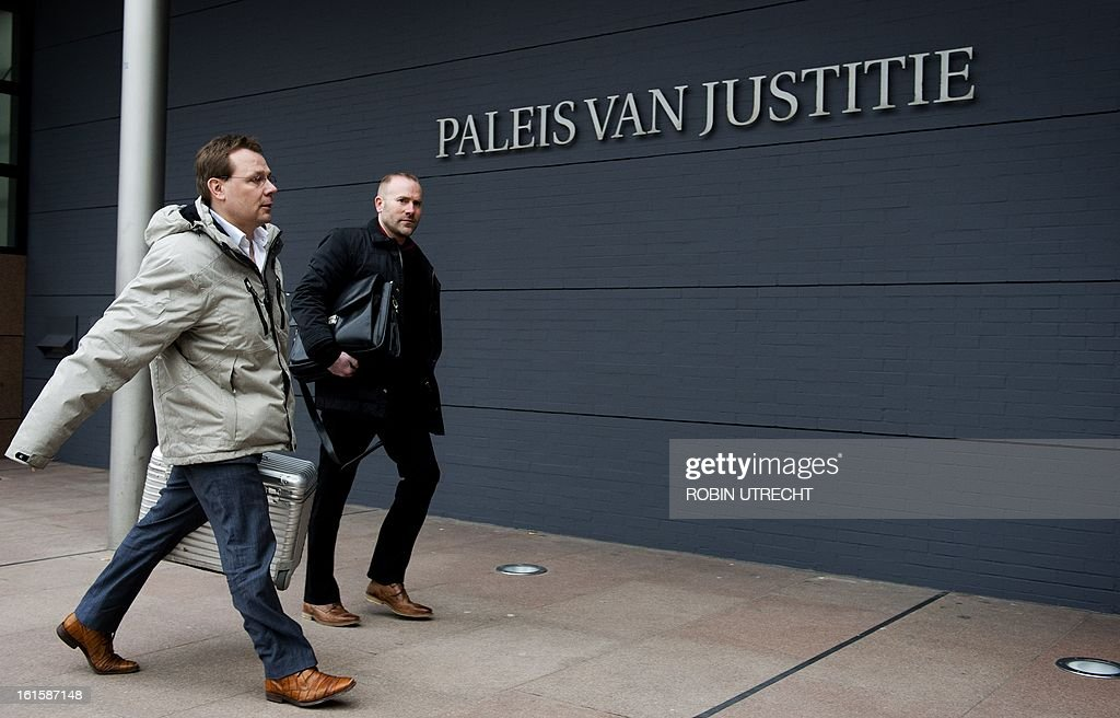 The lawyer of Dutch-Pakistani national Sabir Khan, Andre Seebregts (L), arrives in the courtroom of The Hague, on February 12, 2013, to launch last-ditch effort to stop extradition of Khan to the United States. The US accused Khan of planning at least one suicide attack on a US military target in Afghanistan. AFP PHOTO ANP ROBIN UTRECHT - Netherlands out -