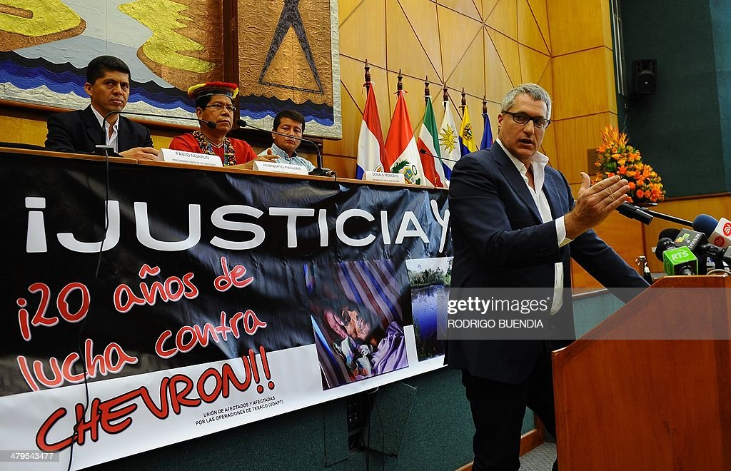 The lawyer of Ecuadorean people affected by Texaco-Chevron --who have long sought compensation for pollution between the 1970s and early 1990s-- Steven Donziger, gestures during a press conference on March 19, 2014 in Quito. Earlier this month, a US judge upheld Chevron's allegations that an Ecuadoran court decision ordering it to pay $9.5 billion for oil pollution in the Amazon jungle was fraudulently obtained. Donziger announced they will appeal against this decision.