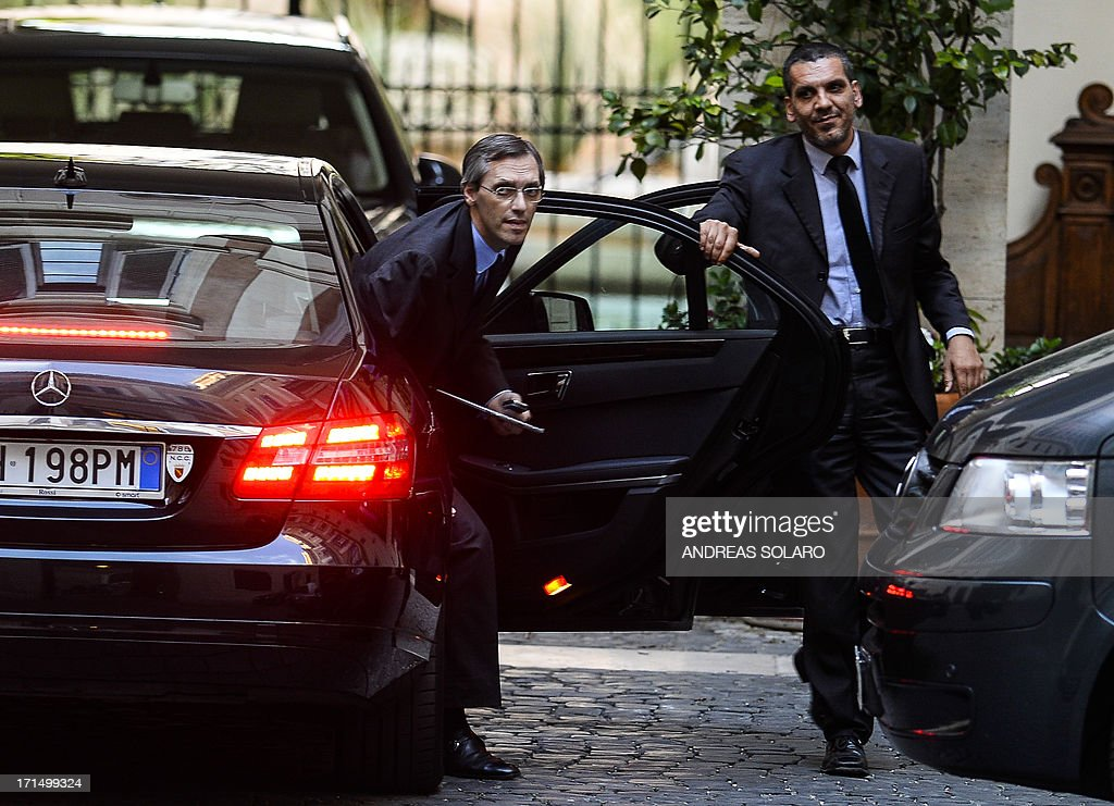The lawyer of former Italian prime Minister Silvio Berlusconi, Niccolo Ghedini, arrives at Palazzo Grazioli (Berlusconi's residence), on June 25, 2013 in Rome. Silvio Berlusconi's furious reaction to a conviction for paying for sex with an underage prostitute suggests a belligerent centre-right will intensify pressure on the coalition government to favour its policies, particularly concerning the hot-button issue of tax, analysts said today. Political observers had warned a guilty verdict could provoke the capricious former premier into pulling support from Enrico Letta's grand coalition, for failing to offer him legal protection. AFP PHOTO / ANDREAS SOLARO