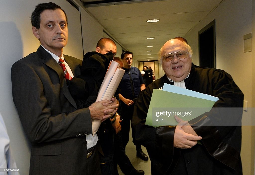 The lawyer representing Belgian sculptor Delphine Boel, Philippe Gregoire (L), and the lawyer defending the Belgian royal family, Guy Hiernaux, stand in a corridor on September 3, 2013 at the Court of First Instance in Brussels. Boel has gone to court to win official recognition as the natural daughter of former Belgian King Albert II. Boel, 45, has filed a suit requiring the former king, his son, Belgian King Philippe, and his daughter Princesse Astrid to appear in a Brussels court. Boel wants to get the court to order a DNA test so as to establish her relationship with the former king.
