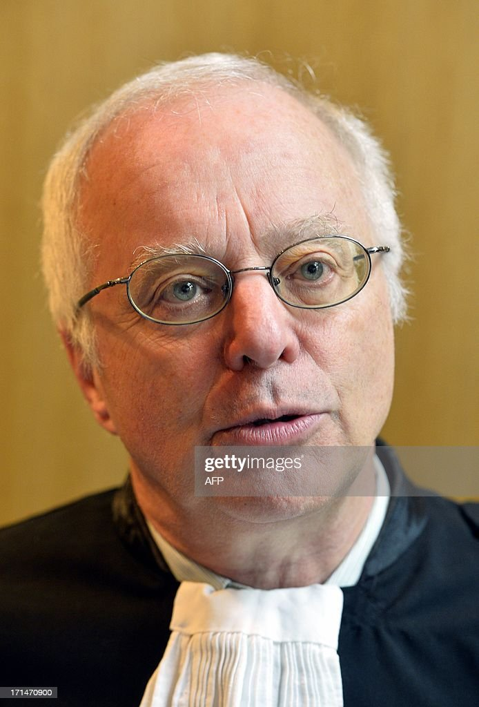 The lawyer representing the Belgium royal family, Alain Berenboom, speaks to journalists during a court recess on June 25, 2013 in Brussels in the case opposing Belgian sculptor Delphine Boel to members of the royal family. Boel has gone to court to win official recognition as the natural daughter of Belgium's King Albert II. Boel, 45, has filed a suit requiring King Albert, his heir Prince Philippe and daughter Princesse Astrid to appear in a Brussels court.