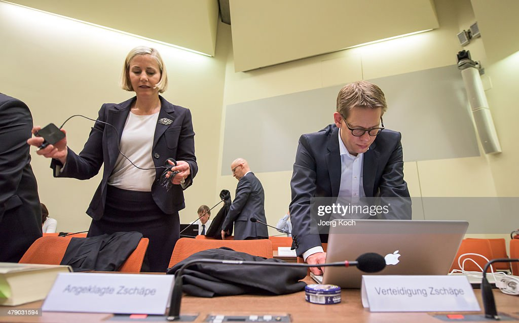 The lawyers of Co-defendant Beate Zschaepe, <a gi-track='captionPersonalityLinkClicked' href=/galleries/search?phrase=Wolfgang+Heer+-+Lawyer&family=editorial&specificpeople=14887066 ng-click='$event.stopPropagation()'>Wolfgang Heer</a> (R) and <a gi-track='captionPersonalityLinkClicked' href=/galleries/search?phrase=Anja+Sturm&family=editorial&specificpeople=10879931 ng-click='$event.stopPropagation()'>Anja Sturm</a> (L), prepare for another day of the NSU neo-Nazi murders trial on June 30, 2015 in Munich, Germany. Zschaepe is the chief defendant among five people accused of assisting Mundlos and Boehnhardt in their eight-year murder spree that targeted nine immigrants and one policewoman.