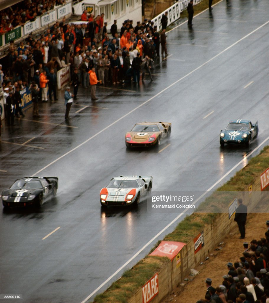The Le Mans 24 Hours Le Mans June 1819 1966 Streaking toward the end of the race the top three Ford GT40 Mk IIs leave sheets of spray behind them...