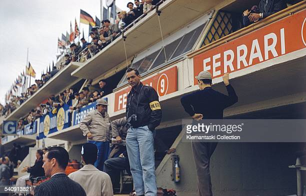 The Le Mans 24 Hours Le Mans June 2223 1957 During the race Phil Hill stands on the pit counter with his camera around his neck He was to drive a...