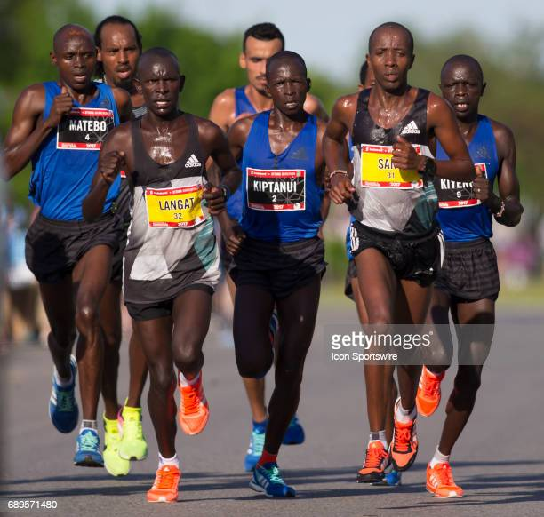 The lead group of runners at the 15km mark left from right Levy Matebo of Kenya Isaac Langat Eliud Kiptanui of Kenya Ezra Sang in the Ottawa Marathon...