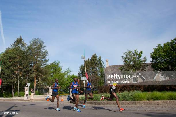 The lead group passes The Prime Minister's residence at 24 Sussex Drive from right to left Ezra Sang Eliud Kiptanui of Kenya Moses Kipsiro of Uganda...