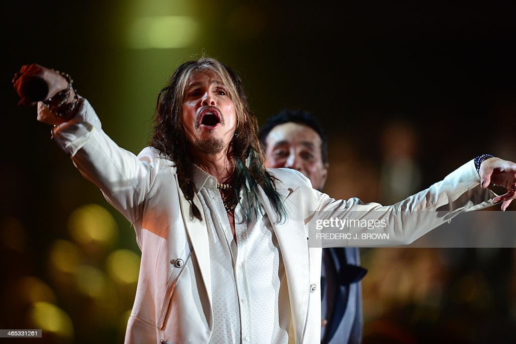 The lead singer of the rock group Aerosmith Steven Tyler performs on stage for the 56th Grammy Awards at the Staples Center in Los Angeles, California, January 26, 2014. AFP PHOTO FREDERIC J. BROWN