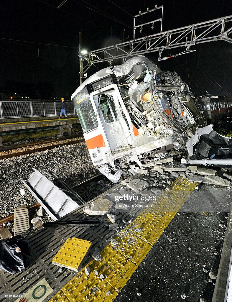 The lead vehicle of the derailed Sanyo Electric Railway Co. train is seen after a collision with a truck at Arai Station on February 12, 2013 in Takasago, Hyogo, Japan. Fifteen people injured by the accident.