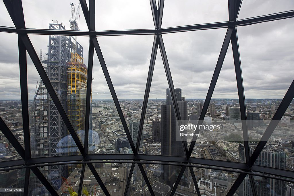 The Leadenhall building, also known as the 'Cheesegrater', left, and Tower 42, are seen from inside the Swiss Re building, also known as the 'Gherkin', in London, U.K., on Sunday, June 23, 2013. U.K. commercial real estate values rose for the first time in 18 months in May, led by increasing demand for offices, Investment Property Databank Ltd. said. Photographer: Jason Alden/Bloomberg via Getty Images