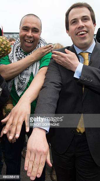 The leader of 'Debout Les Belges' farright lawmaker and chamber member Laurent Louis and one of his supporters perform the controversial 'quenelle'...
