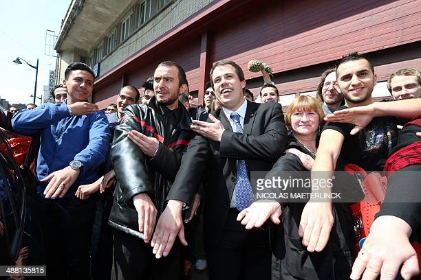 The leader of 'Debout Les Belges' farright lawmaker Laurent Louis perform the 'quenelle' gesture ahead of the antiSemitic congress 'First European...