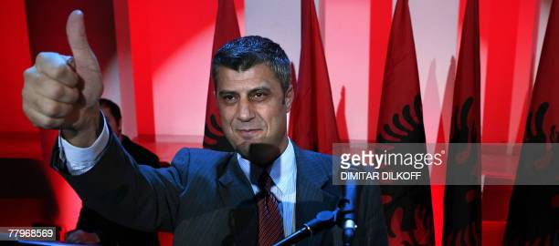 The leader of Democratic Party of Kosovo Hashim Thaci gives the thumbup as he greets his supporters after claiming victory in Kosovo's parliamentary...