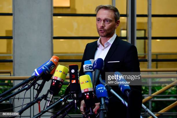 The leader of Germany's free democratic FDP party Christian Lindner makes a statement as members of the delegations of the CDU/CSU conservative...