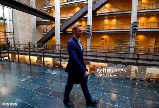 The leader of Germany's free democratic FDP party Christian Lindner leaves after exploratory talks with party members of the Greens on October 19...