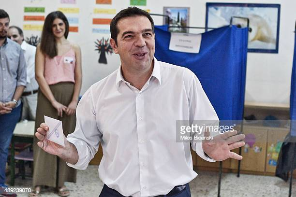 The leader of Greece's leftwing Syriza party Alexis Tsipras casts his ballot at a polling station on September 20 2015 in Athens Greece The latest...