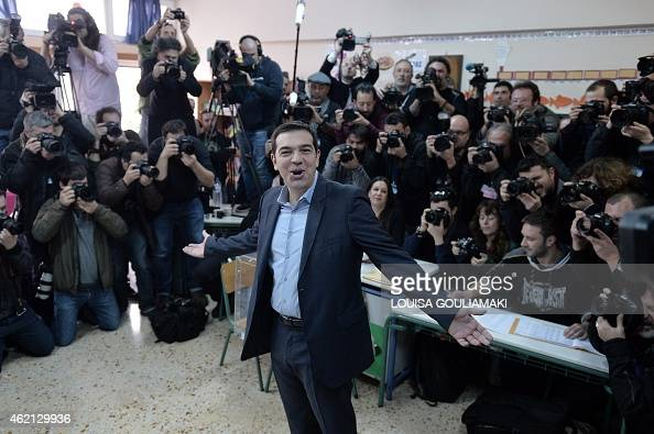 The leader of Greece's leftwing Syriza party Alexis Tsipras poses prior to cast his ballot at a polling station in Athens on January 2015 Greece...