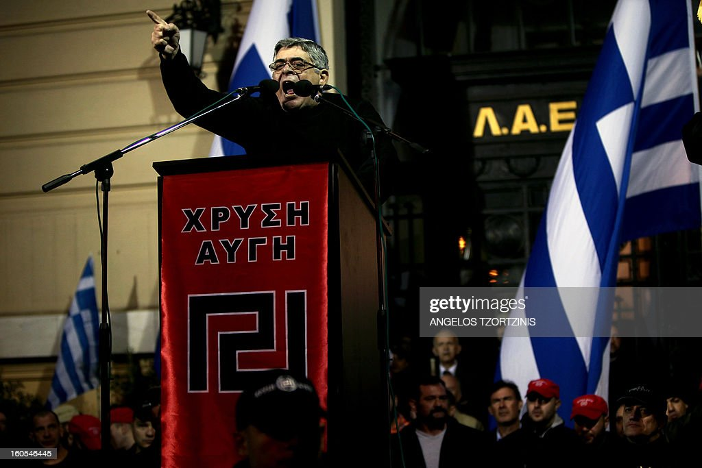 The leader of Greek ultra nationalist Golden Dawn party, Nikos Michalioliakos speaks on February 2, 2013 during a gathering of Greek nationalists in central Athens, to commemorate the death of three Greek military officers. The crew of a Greek army helicopter crashed on January 31 at open sea in the Imia islets, at the Greek-Turkish sea borders, during a military crisis and subsequent dispute between the two countries over sovereignty of the islets in 1996.