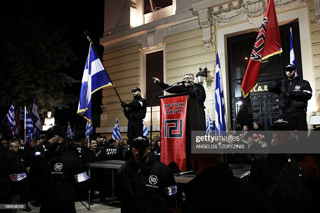 The leader of Greek ultra nationalist Golden Dawn party, Nikos Michalioliakos (C) speaks on February 2, 2013 during a gathering of Greek nationalists in central Athens, to commemorate the death of three Greek military officers. The crew of a Greek army helicopter crashed on January 31 at open sea in the Imia islets, at the Greek-Turkish sea borders, during a military crisis and subsequent dispute between the two countries over sovereignty of the islets in 1996.