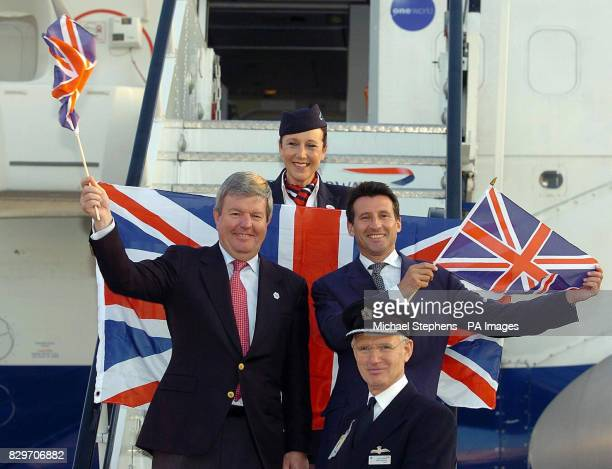 The leader of London's bid to stage the Olympic Games in 2012 Lord Coe waves the flag with chief executive Keith Mills Captain Mike Johnson and...