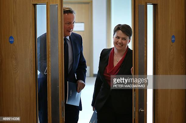 The leader of Scottish Conservatives Ruth Davidson walks with British Prime Minister David Cameron as they launch the Scottish conservative election...