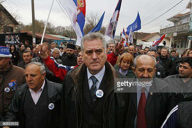 The leader of Serbia's extreme nationalist Serbian Radical Party Tomislav Nikolic walsk with supporters during a visit to the Kosovo Serb enclave of...