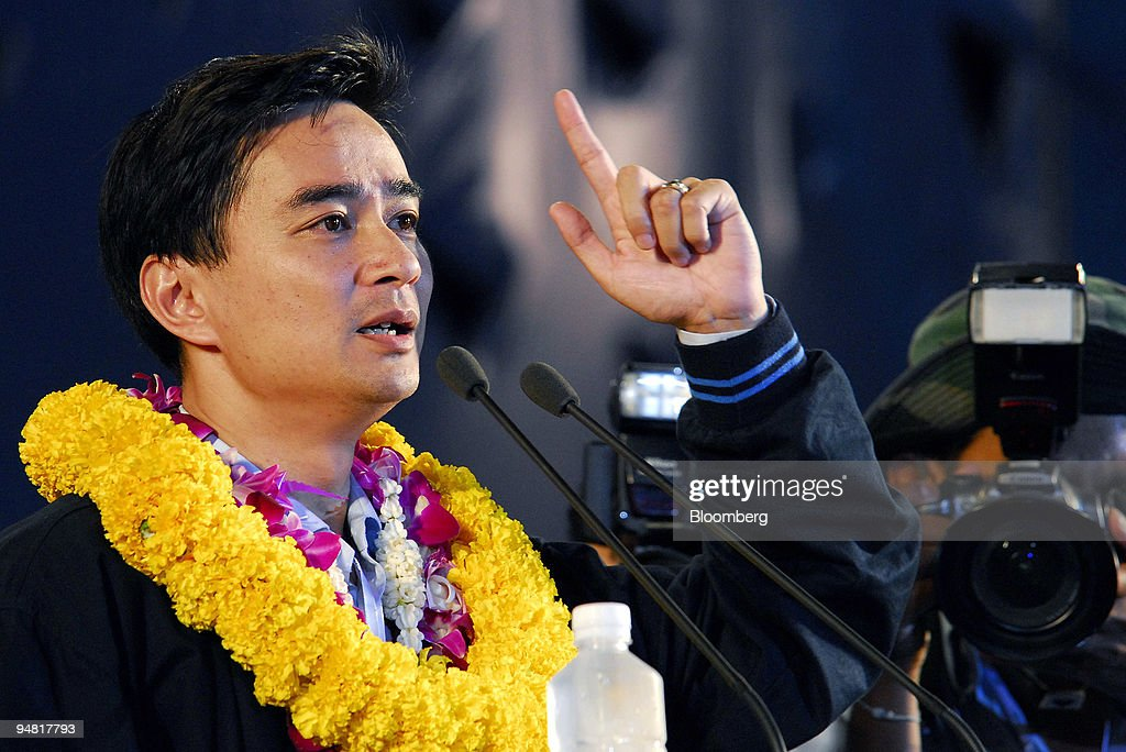 The leader of Thailand's Democrats party, <a gi-track='captionPersonalityLinkClicked' href=/galleries/search?phrase=Abhisit+Vejjajiva&family=editorial&specificpeople=645779 ng-click='$event.stopPropagation()'>Abhisit Vejjajiva</a>, speaks at a mass rally in Bangkok on Friday March 24, 2006. Thailand's three main opposition parties are boycotting the election, which may delay or invalidate the results if poor voter turnout and uncontested seats leave parliament short of the 500 members needed.