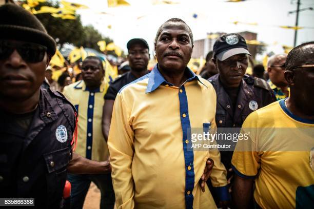 The leader of the Angolan opposition party CASACE Abel Chivukuvuku is led to the podium at an electoral rally in Luanda on August 20 2017 / AFP PHOTO...
