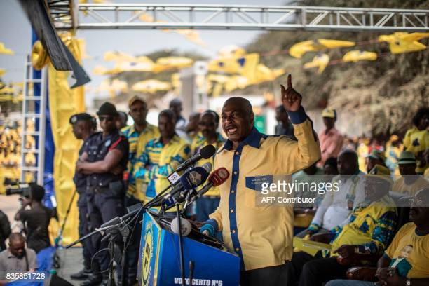 TOPSHOT The leader of the Angolan opposition party CASACE Abel Chivukuvuku gestures while delivering a speech to his supporters during a rally in...