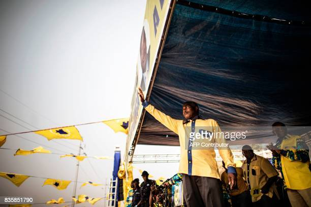 TOPSHOT The leader of the Angolan opposition party CASACE Abel Chivukuvuku greets his supporters from the stage during a rally in Luanda on August 20...