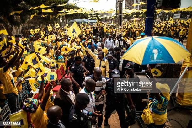 The leader of the Angolan opposition party CASACE Abel Chivukuvuku acknowledges the crowd as he is led to the podium at an electoral rally in Luanda...