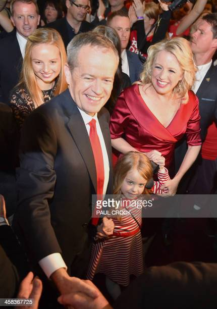 The leader of the Australian Labor Party Bill Shorten smiles as he arrives with daughter Clementine and wife Chloe to give a speech about the success...