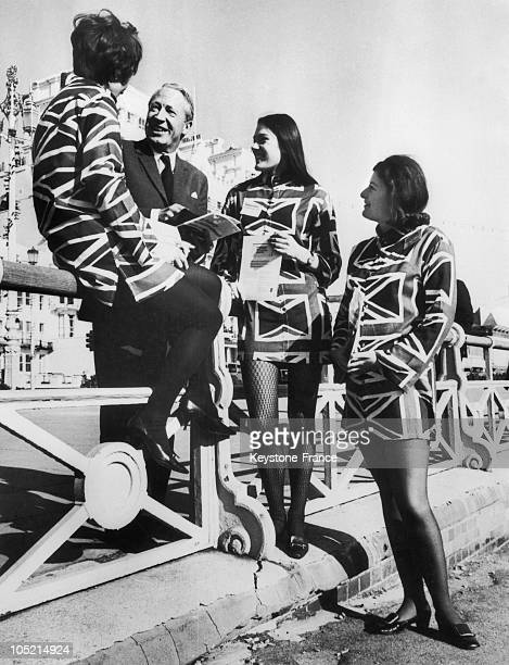 The Leader Of The British Conservative Party Edward Heath Speaking With Three Young Girls Who Were Selling Some Booklets Commemorating The 100Th...