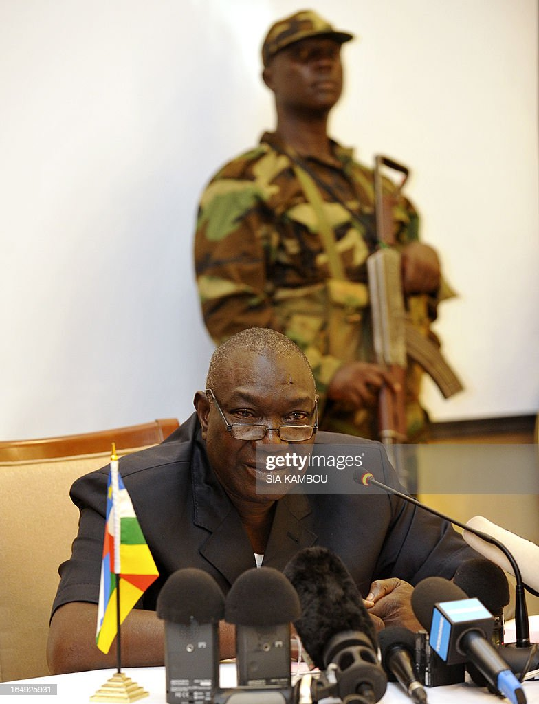 The leader of the Central African rebel coalition Seleka, Michel Djotodia speaks during a press conference on March 29, 2013 in Bangui. The Red Cross in the Central African Republic said today it had found some 78 bodies in the streets of the capital Bangui since it fell to rebels last weekend, as jittery residents waited to hear about a new government. Drinking water and electricity were cut off in parts of Bangui, whose seizure by the Seleka rebel coalition, led by strongman Michel Djotodia, forced president Francois Bozize to flee and sparked a rampage by groups of armed looters. AFP PHOTO / SIA KAMBOU
