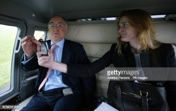 The leader of the Conservative party Michael Howard and his polictical Secretary Rachel Whetstone working on the flight to Norwich