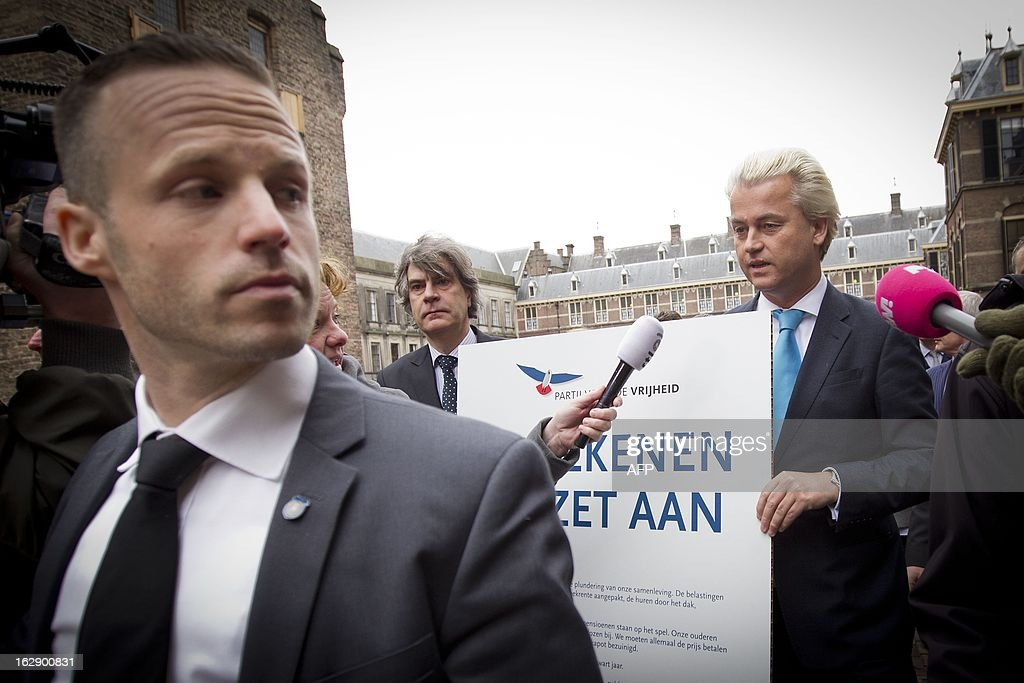 The leader of the Dutch far-right Party for Freedom (PVV) Geert Wilders (R) carries, together with the PVV fractions of the opposition and the Senate, a protest pamphlet which he will hand over to the Dutch cabinet in The Hague, The Netherlands, on March 1, 2013. The PVV fractions protest against the austerity package of 4.5 billion euros, in addition to 16 billion that has been already agreed in the coalition. AFP PHOTO / ANP EVERT-JAN DANIELS netherlands out - belgium out