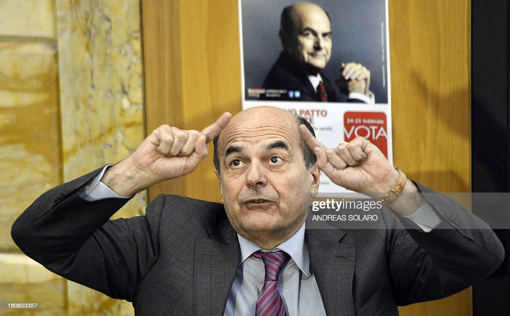 The leader of the Italian center left Democratic Party (PD) Pier Luigi Bersani gestures while speaking on February 6, 2013 at a public debate with the healthcare personnel of the Forlanini hospital in Rome during a campaign for the upcoming general elections.