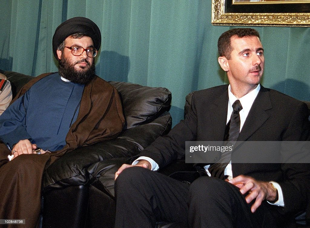 The leader of the Lebanese Shiite Muslim guerrilla group Hezbollah, Sheikh <a gi-track='captionPersonalityLinkClicked' href=/galleries/search?phrase=Hassan+Nasrallah&family=editorial&specificpeople=615774 ng-click='$event.stopPropagation()'>Hassan Nasrallah</a> (L), visits Syrian heir apparent Bashar al-Assad 15 June 2000 to offer his condolences over the death of his father, President Hafez al-Assad. Hezbollah, which is backed by Syria, spearheaded the Lebanese armed resistence against Israel's occupation of south Lebanon until the latter's withdrawal last month after 22 years of occupation.