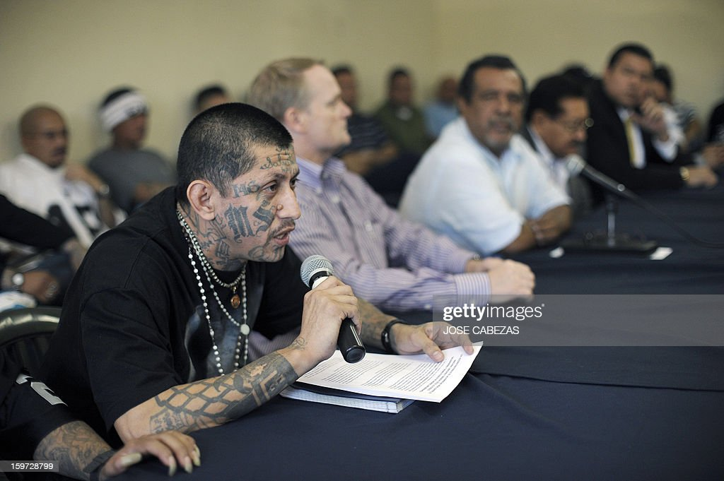 The leader of the Mara Salvatrucha gang, Carlos Alberto Valladares, reads a press release during a press conference at La Esperanza Penitenciary in San Salvador, El Salvador on January 19, 2013. Leaders of Salvadorean MS-13, 18th street, Mara Maquina and Mao-Mao gangs participated in a press conference with the Secretary of Multidimensional Security at the Organization of American States (OAS) Adam Blackwell during a campaign to reduce crime in El Salvador. AFP PHOTO/ Jose CABEZAS