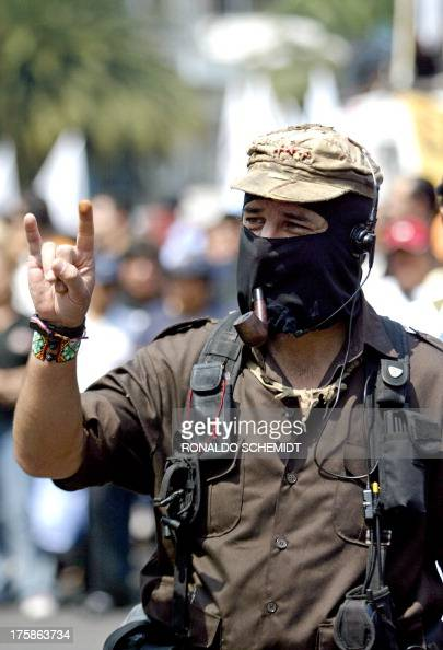 The leader of the Mexican Zapatista Army for National Liberation 'Subcomandante Marcos' gestures 28 May 2006 in Mexico City during a demonstration in...