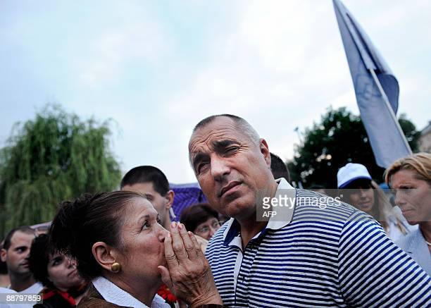 The leader of the new centerright Citizens for European Development of Bulgaria party Sofia Mayor Boiko Borisov listens to a supporter as he attends...