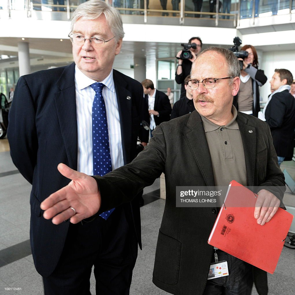 The leader of the Opel works council Klaus Franz (R) gestures to the CEO of Opel, Nick Reilly shake hands at the Opel plant in the central German city of Ruesselsheim on May 21, 2010. General Motors' European unit Opel and unions have agreed on terms of a long-awaited restructuring plan, knocking the ball back into Berlin's court, with GM hoping for financial guarantees in return.