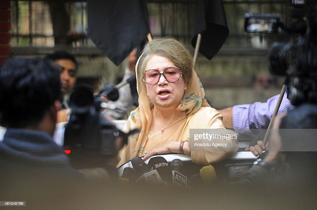 The leader of the opposition Bangladesh Nationalist Party, <a gi-track='captionPersonalityLinkClicked' href=/galleries/search?phrase=Khaleda+Zia&family=editorial&specificpeople=647544 ng-click='$event.stopPropagation()'>Khaleda Zia</a> addresses supporters from her office compound ahead of the first anniversary of elections boycotted by her party in the capital city Dhaka, Bangladesh on January 05, 2015. More than 100 police were stationed outside the gate of her office to stop anyone entering or leaving. Zia had planned to attend a rally on the first anniversary of disputed January 05, 2014 elections despite a police ban on protests in the capital city, Dhaka.