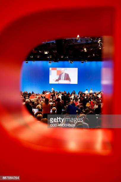 The leader of the Social Democratic Party Martin Schulz is seen through the 'P' letter of the party logo as he delivers a speech during a party...