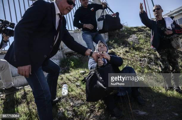 The leader of the United Patriots is pulling an old 80 years BulgarianTurk woman BulgarianTurk woman is crossing the Kapitan Andreevo crossing point...